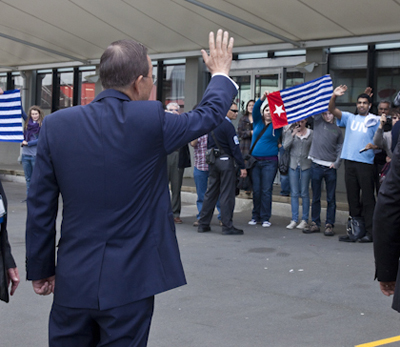 Ban Ki-moon waving to West Papuan protesters at Auckland University. Photo: Karen Abplanalp / PMC