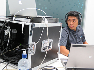 AUT's live stream technician Joseph Mamauag at the climate change seminar last night. Image: Del Abcede/PMC