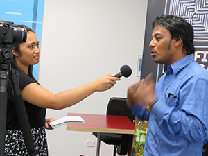 Pacific Media Watch's Alistar Kata interviews Taberannang Korauaba last night. Image: Del Abcede/PMC