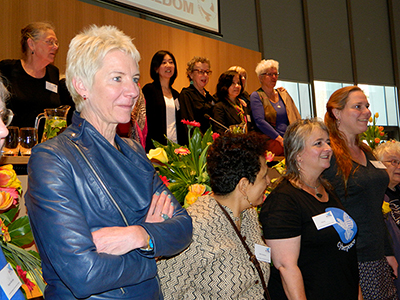WILPF's Madeleine Rees stands with other women at the 2015 conference in the Netherlands. Image: Del Abcede/ PMC