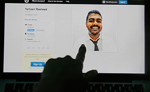A Sri Lankan woman in Colombo points to a photo of murdered Maldivian blogger Yameen Rasheed from his blog. Image: Eranga Jayawardena/CPJ