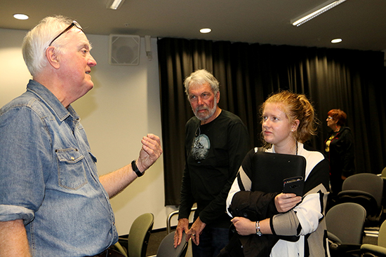 Murray Horton speaking to broadcaster Ray Mankelow and Pacific Media Watch journalist Kendall Hutt with Sally James in the background at the seminar. Image: Del Abcede/PMC
