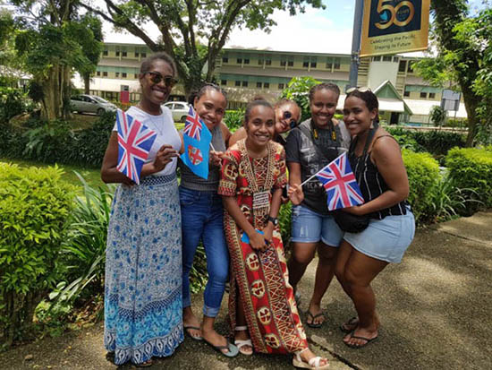 Solomon Islands student Cynthia Hou (middle) is flanked by friends at USP's Laucala campus. Image: Mereoni Mili/Wansolwara
