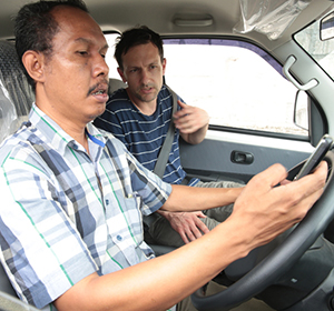 Tabloid Jubi editor Victor Mambor (at wheel) with Johnny Blades in West Papua. Image: RNZ Pacific