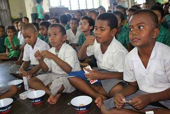 Year One students of Adi Maopa Primary School enjoy their cereal meal. Image: Sophie Ralulu/IB