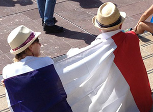 Freedom of speech supporters draped in the French national flag today. Image: TV3