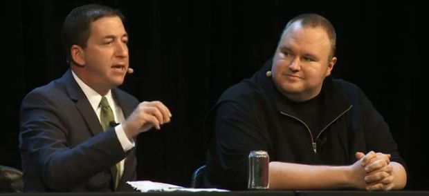 Pulitzer prize winning journalist Glenn Greenwald (left) and Kim Dotcom at the meeting in Auckland last night.