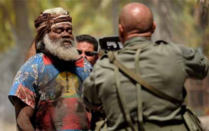 A French military in terrogator holds a gun at the head of a Kanak elder during the search for the hostage cave. Image: Rebellion
