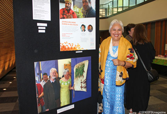 Victoria University's Assistant Vice-Chancellor (Pacific) Laumanuvao Winnie Laban at the celebration last  night next to a photo of her opening the centre in 2007. Image: Mata Lauano/Spasifik