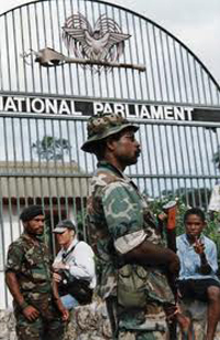 PNG soldiers on guard outside Parliament during the 1997 Sandline crisis. Photo: PMC archive